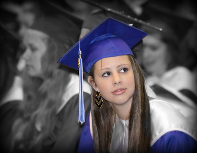 We have done it. Our fifth Graduate. I caught her looking up trying to find her most important friend,,,, Her MOM..Hope everyone has a great day...
