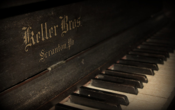 A shot of a piano in our home. Its a beautiful piece of furniture to bad I can't  play it,,,,, The company I found went out of business during the Great Depression I have been told the piano dates back to approx 1915 to 1920. Just a neat piece to have a round. Have a great day everyone. And Thank You for all the great comments you all put up daily...
